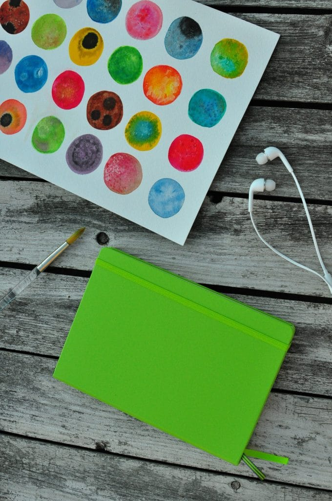 nicole peery watercolor painting and green notebook